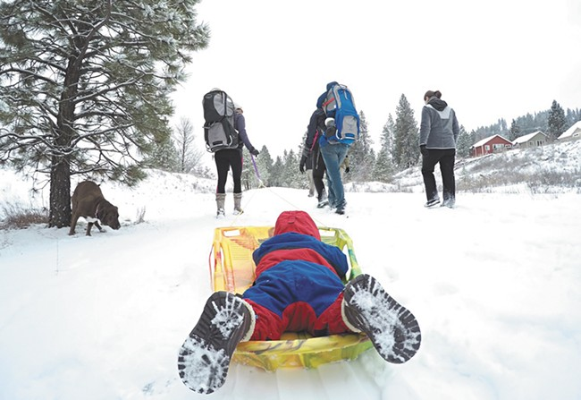 "The ""Hike It Baby"" group gathers for a snowy walk on Spokane's Fish Lake trail. - JOE KONEK"