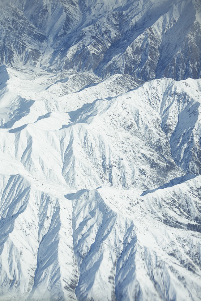 The Hindu Kush Mountains of Kyrgyzstan are photographed from a KC-135. - YOUNG KWAK