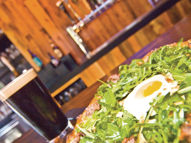 The Kiernan at the Flying Goat: Italian sausage and arugula topped with an over-medium egg. The pub has nitro tap for beers like Rogue's Shakespeare Stout. - TAMMY MARSHALL