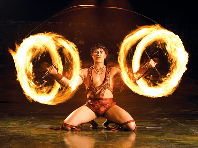 The knife-fire dance in Cirque du Soleil: Alegria
