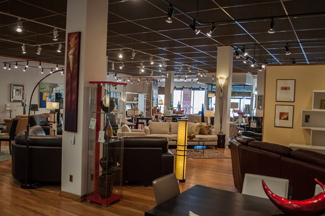 The first floor showroom at Dania Furniture, where employees have reported strange incidents like beds being unmade overnight and shadowy figures walking around. - SARAH WURTZ
