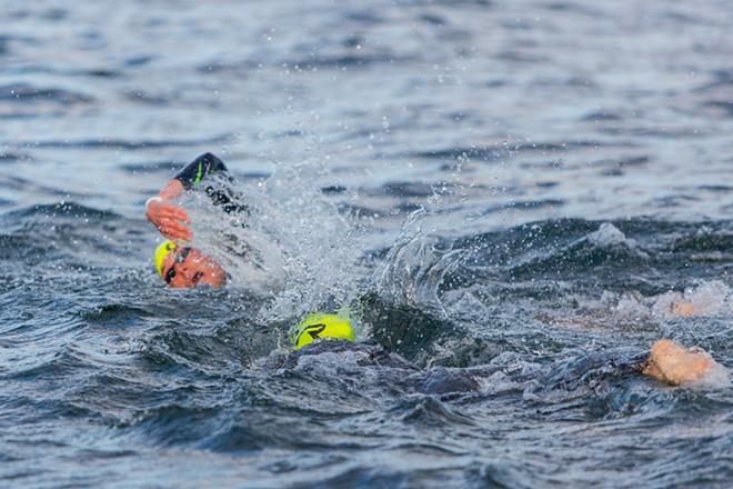 The professional women swim in Lake Coeur d'Alene. - MATT WEIGAND