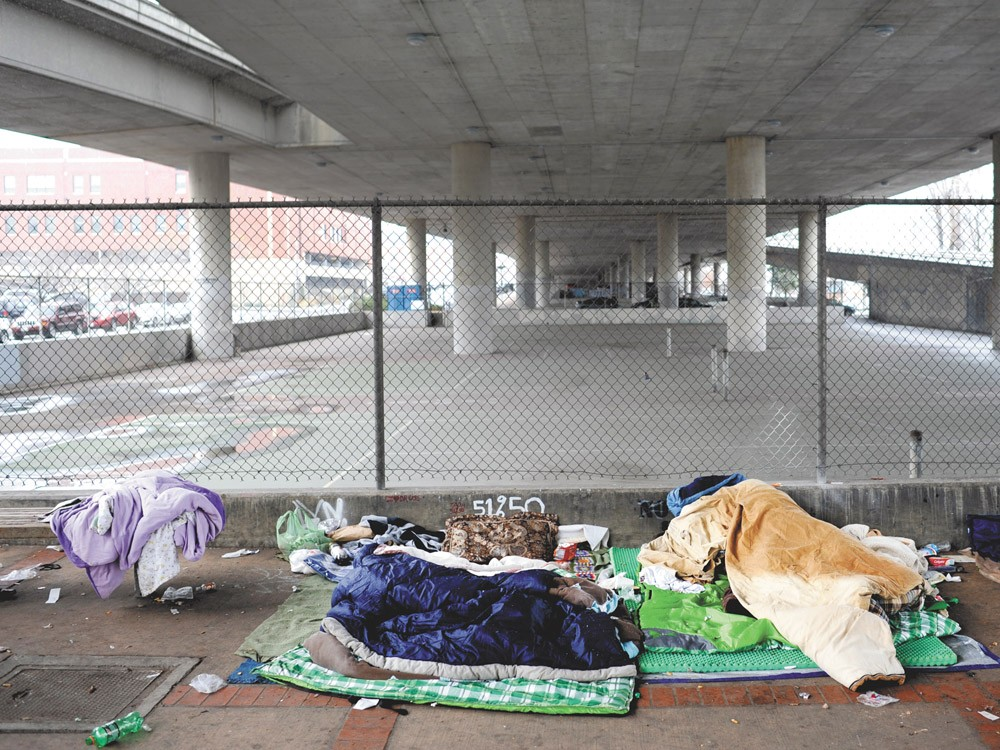 The scene under the freeway in downtown Spokane last Friday. - CHRISTIAN WILSON