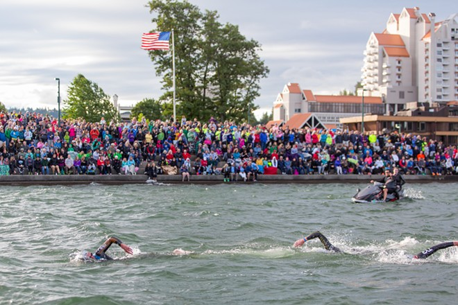 The second, third and fourth place men swim to shore for the start of their second lap at  the Coeur d'Alene Ironman. - MATT WEIGAND