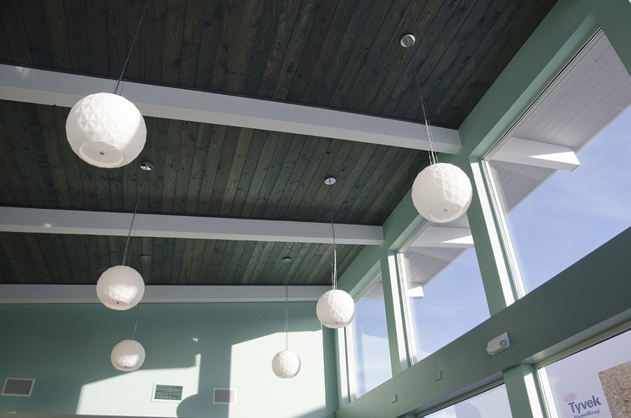 The interior has a retro diner feel with modern touches, like the lighting and green-tinted wooden ceiling. - LISA WAANANEN