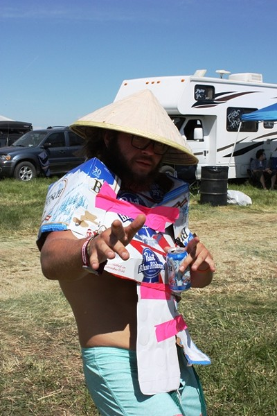 This guy fashioned a cardboard shawl out of last night's beverage containers. - LAURA JOHNSON