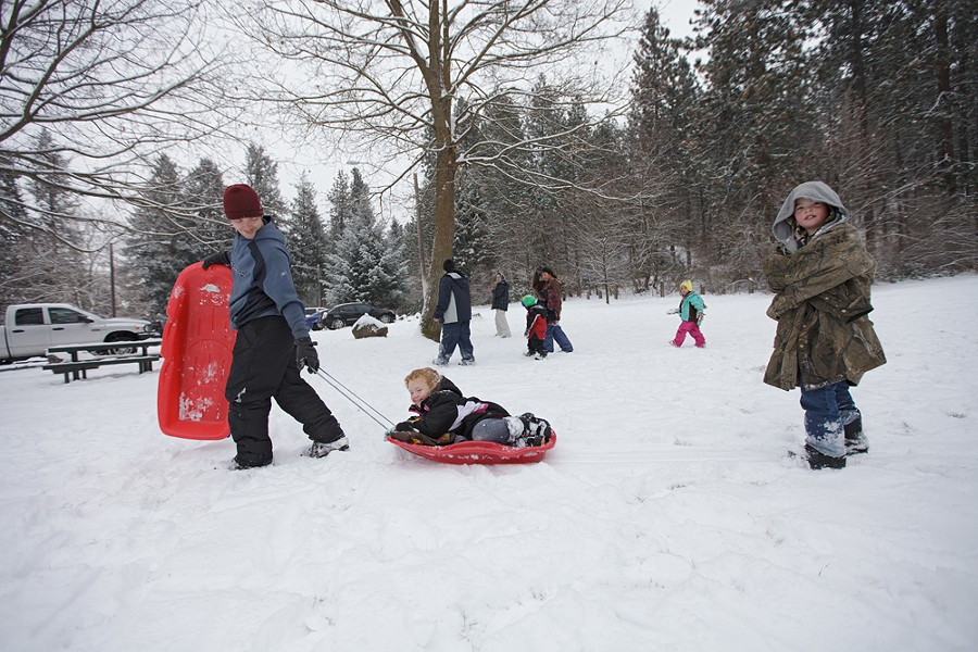 Thomas Bakken, left, pulls his daughter on a sled as his son follows. - YOUNG KWAK