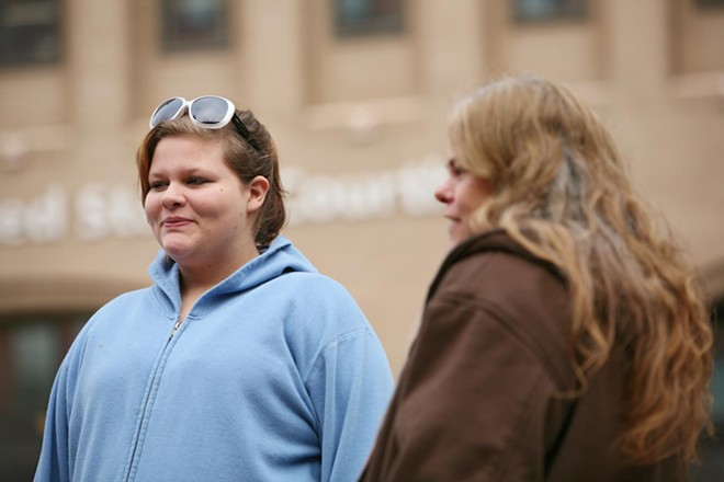 15-year-old Maranda Braschers, left, and her mother Rhonda stand in front of the Thomas S. Foley U.S. Courthouse in Spokane, Wash. on Thursday, November 15, 2012. As an 8-year-old in 2006, Maranda witnessed police confronting Otto Zehm at a Zip Trip store. - YOUNG KWAK