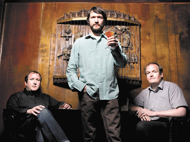Tim Kasher (center) and Cursive