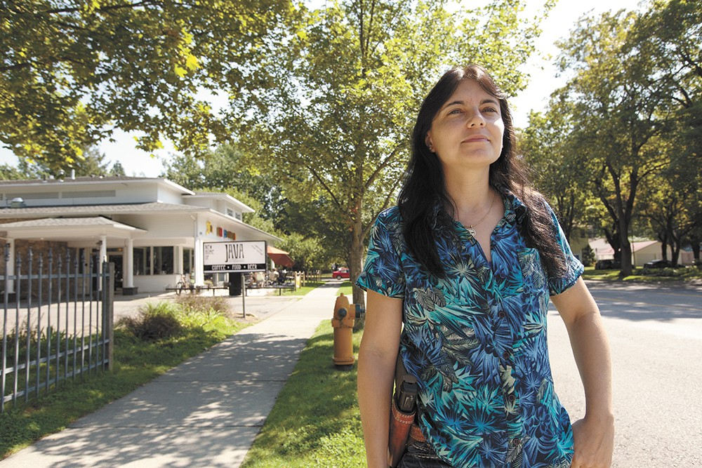 Tina Kunishige, near where Arfee was shot by a police officer, is one of many still upset with how Coeur d'Alene has handled the tragedy. - YOUNG KWAK