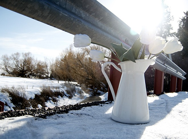 Flowers at the site where University of Idaho freshman Joseph Wiederrick's body was recovered last month. - JACOB JONES