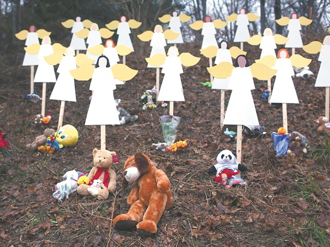 Twenty-seven wooden angels stand in a yard down the street from the Sandy Hook School in Newtown. - SPENCER PLATT | GETTY IMAGES