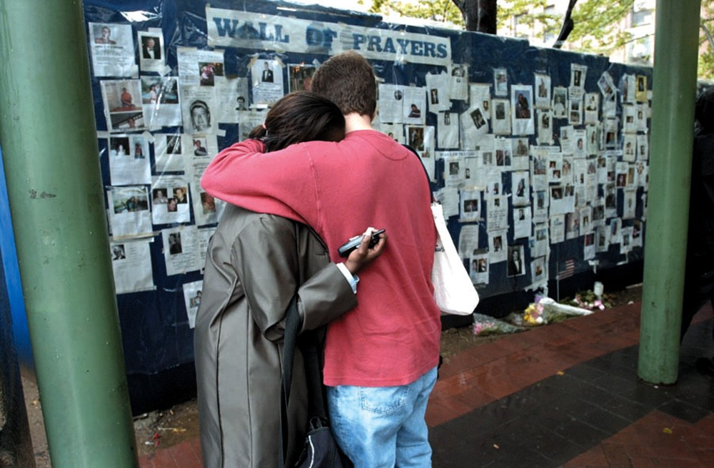 Two New Yorkers at the wall of prayers after 9/11.