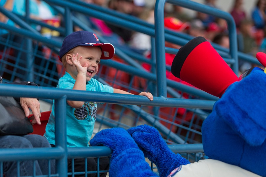 Two-year-old Ethan Bordoeux high fives Otto from the stands. - MATT WEIGAND