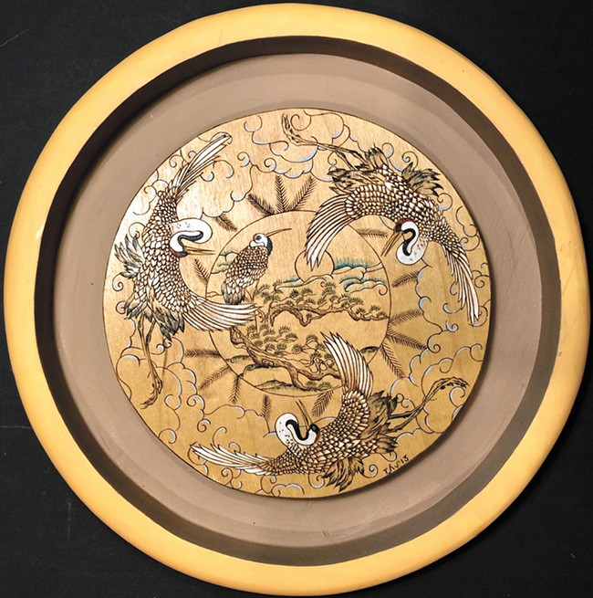 A piece of wood-burned art by Jerry White at Pottery Place Plus.