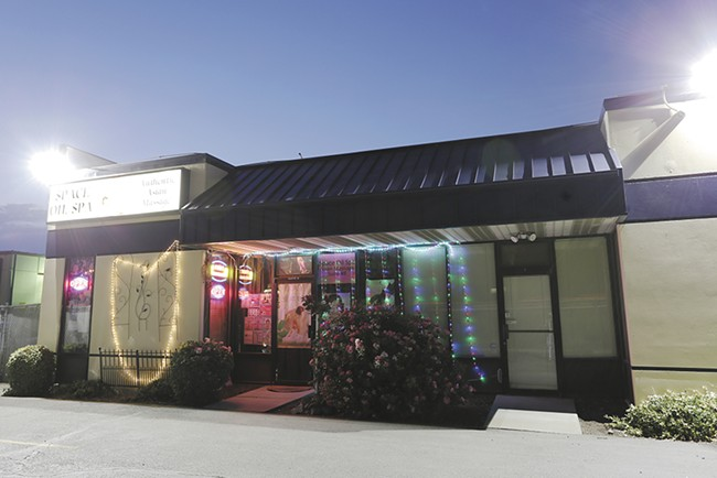 Law enforcement officials raided Space Oil Massage on July 12, but the spa remains open for business. - YOUNG KWAK