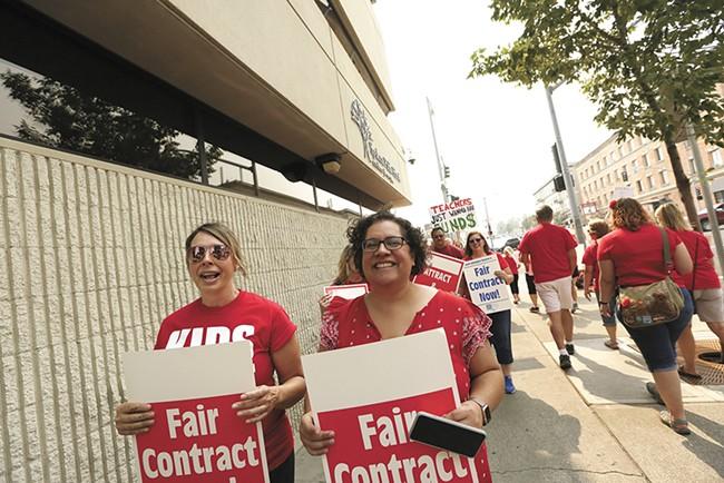 Spokane teachers demand pay raises. - YOUNG KWAK