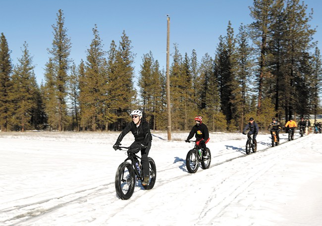 Fat-tire bike riders head out on a trail at the 7 mile area of Riverside State Park. - YOUNG KWAK