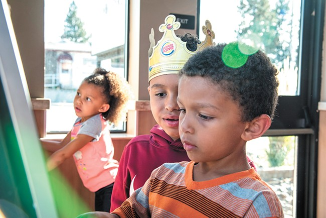 Isaiah (wearing the crown) reunited with his younger brother and sister, Thomas and Charlotte, in a Burger King play place. |erick doxey photo - YOUNG KWAK