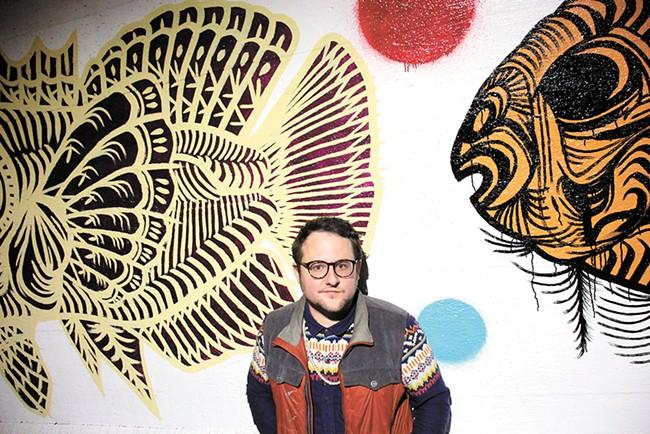 Spokane muralist Matt Smith and his new work on Stevens Street. - QUINN WELSCH PHOTO