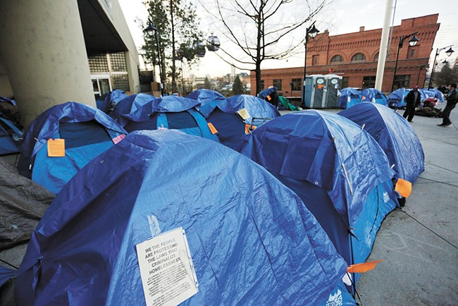 Weeks after city officials hoped new homeless shelters would be online, activists and homeless people erected a tent city outside City Hall. - YOUNG KWAK
