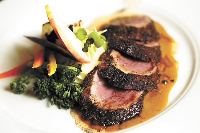 Wild Sage executive chef Charlie Conner's pork tenderloin au poivre from the restaurant's winter menu. - YOUNG KWAK PHOTO
