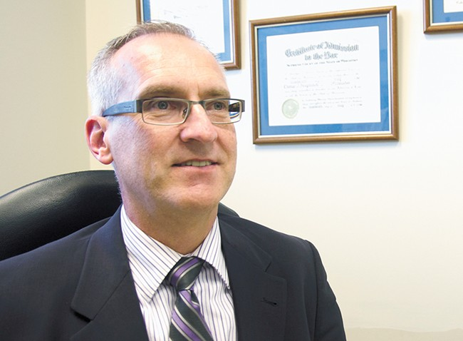 """Tom Krzyminski, director of the County Public Defender's Office: """"There really isn't a lot of room in there for sitting around doing nothing. Everyone's working."""""""