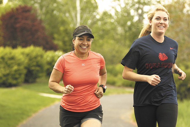 Karen Rickel (left), Gonzaga University assistant professor and chair of the department of sport and physical education, running with recent sports management grad Maggie Reingold. - YOUNG KWAK