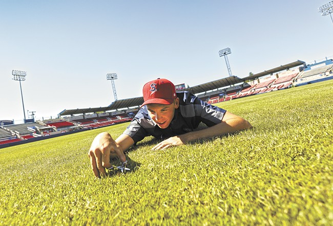 Spokane Indians' head groundskeeper David Yearout keeps a close eye on the grass at Avista Stadium. - YOUNG KWAK