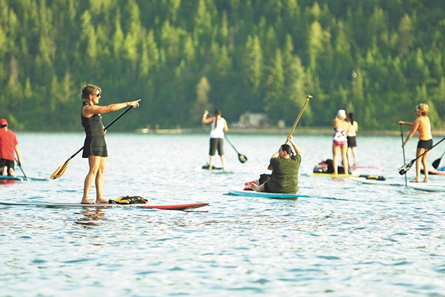 Kym Murdoch leads a class of paddle boarders on Lake Coeur d'Alene. - YOUNG KWAK