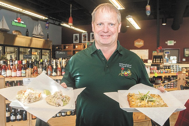 Williams Seafood Market owner Mike Offield with a couple dishes from the store's recently added restaurant. - MEGHAN KIRK