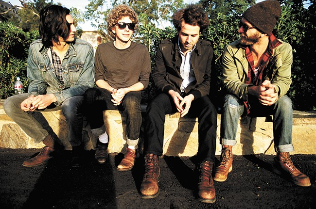 Dawes' bass player Wylie Gelber, far left, says his band's tour bus smells like socks.