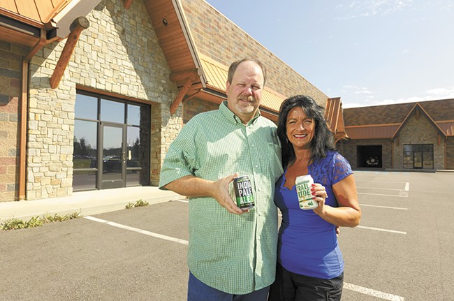 Laughing Dog co-owners Fred and Michelle Colby outside the future Laughing Dog Brewing production facility. - YOUNG KWAK