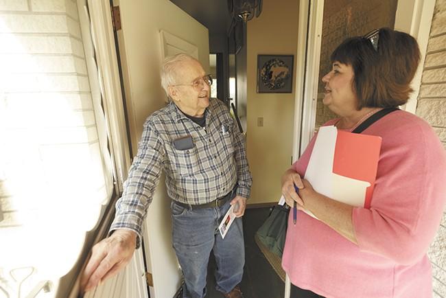 Karen Stratton speaks with voter Millard Lamb while door-belling. - YOUNG KWAK