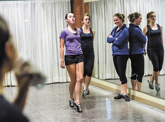 Irish dance teacher Caitlin Truslter, in blue, instructs her championship dancers at her South Perry District studio. - JEFF FERGUSON