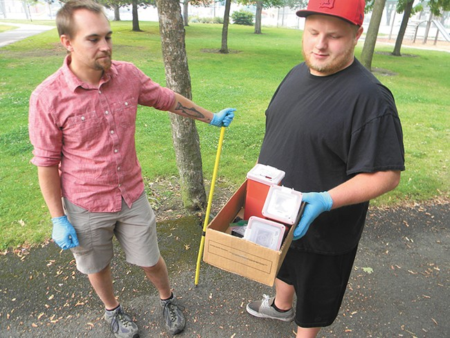 Ben Baird (left) and Shaw Jones help clean up the park. - JAKE THOMAS