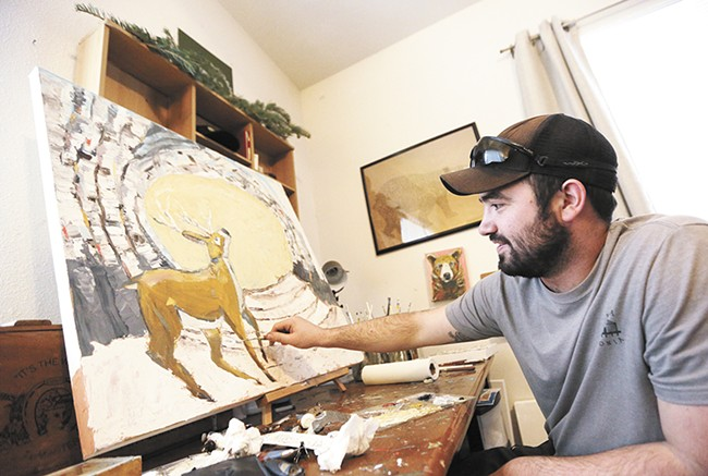 Jeff Weir at work in his home studio in Post Falls. - YOUNG KWAK