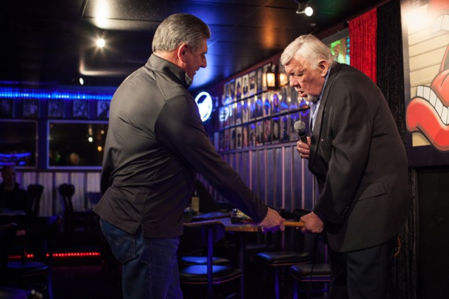 "Don ""Uncle D"" Parkins hands Jay Wendell Walker his cane at open mic night at Parkins' club. - KIRSTEN BLACK"