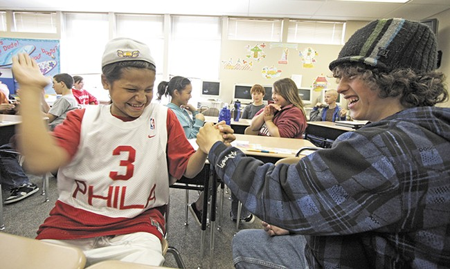 Chad Browneagle (left) and Eli Peterson share a laugh. Proponents of the new education law say it will benefit both native and non-native students. - YOUNG KWAK