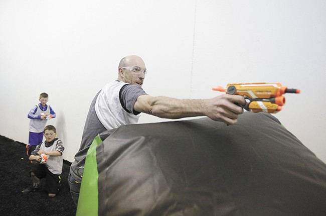 Brian Meier shoots a Nerf gun at Xtreme Arena, where adults can get in on the fun. - YOUNG KWAK