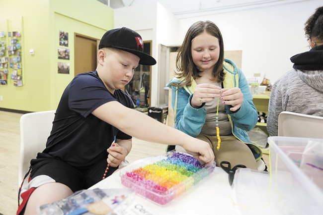 Sixth graders Owen and Jazmyn make bracelets as part of class. - YOUNG KWAK