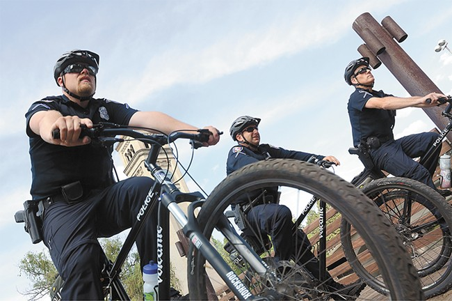 Officers Casey Jones, Micah Prim and John O'Brien (from left) try to patrol at least a few hours a day on bikes. That allows them to interact more with the community and sneak up on criminals. - MIKE SALSBURY