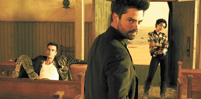 Dominic Cooper (center) stars as a cursed man of God in AMC's Preacher.