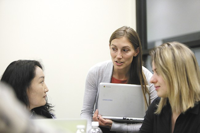 Instructor Tera Ray, right, talks with a student at Spokane College of English Language. - YOUNG KWAK