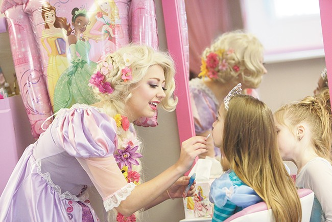 In the role of Rapunzel, Lauren Block entertains a group of young girls during a recent princess birthday party. - YOUNG KWAK