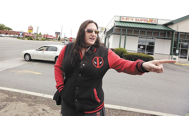 Lacey Hendrix in front of the spot where a driver hit her on her bike two years ago. - YOUNG KWAK