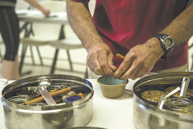 """Max Manjit Mohan teaches Indian cooking in Moscow, hoping to """"demystify"""" the cuisine. - TARYN PHANEUF"""
