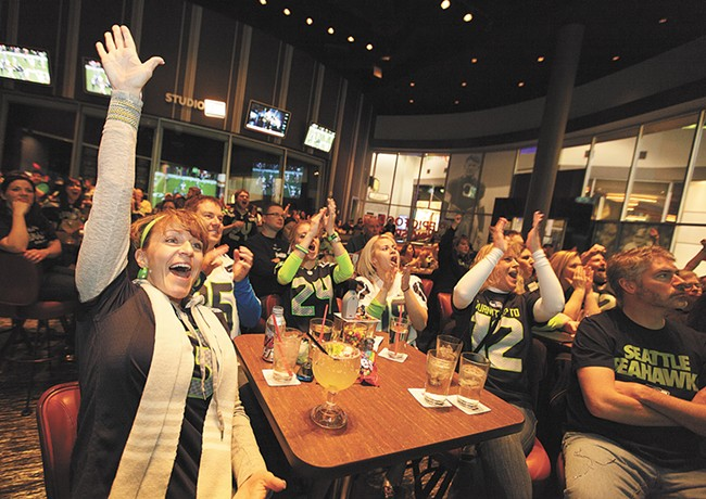 Seahawks fans celebrate the 2014 NFC Championship. - YOUNG KWAK