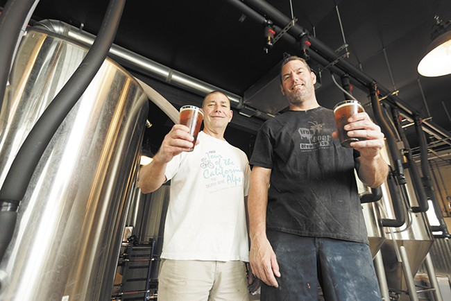 Head brewer Zach Shaw, left, and owner Chris Bennett sample their work at Bennidito's Brewpub. - YOUNG KWAK