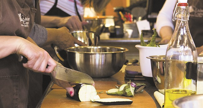 Students get hands-on experience at the Kitchen Engine's  farm-to-table cooking class. - EMMA ROGERS